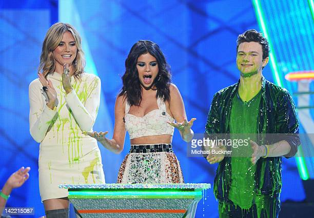 Actress Selena Gomez accepts the Favorite TV Actress award onstage from presenters Heidi Klum and Chris Colfer at Nickelodeon's 25th Annual Kids'...