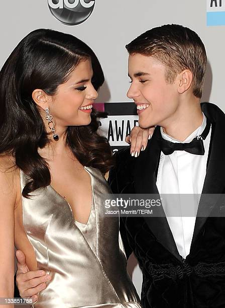 Actress Selena Gomez and musician Justin Bieber arrive at the 2011 American Music Awards held at Nokia Theatre LA LIVE on November 20 2011 in Los...