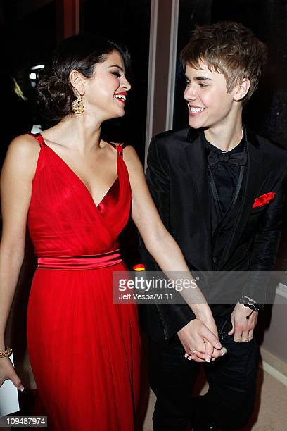 Actress Selena Gomez and musician Justin Bieber attend the 2011 Vanity Fair Oscar Party Hosted by Graydon Carter at the Sunset Tower Hotel on...