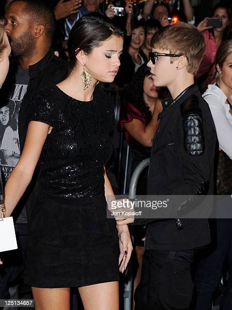 Actress Selena Gomez and singer Justin Bieber arrive at the Los Angeles Premiere 'Abduction' at Grauman's Chinese Theatre on September 15 2011 in...