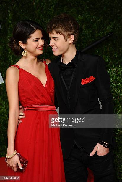 Actress Selena Gomez and singer Justin Bieber arrive at the Vanity Fair Oscar party hosted by Graydon Carter held at Sunset Tower on February 27 2011...