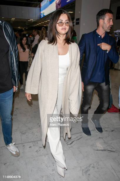 Actress Selena Gomez arrives ahead the 72nd annual Cannes Film Festival at Nice Airport on May 13 2019 in Nice France
