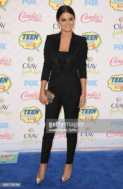 Actress Selena Gomez arrives at the 2014 Teen Choice Awards at The Shrine Auditorium on August 10 2014 in Los Angeles California
