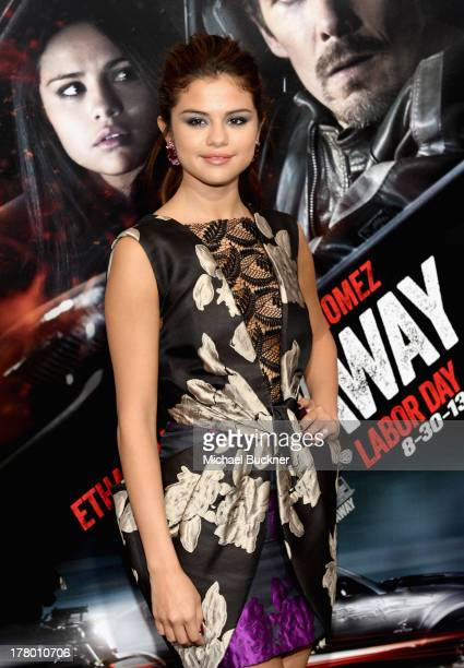 Actress Selena Gomez arrives at the global 'Getaway' movie premiere featuring the Shelby GT500 Super Snake on the red carpet at Regency Village...