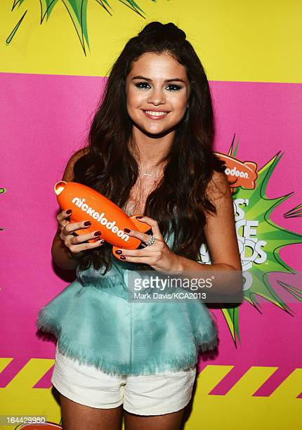 Actress Selena Gomez holds the Kids' Choice Award for Favorite Television Actress backstage at Nickelodeon's 26th Annual Kids' Choice Awards at USC...
