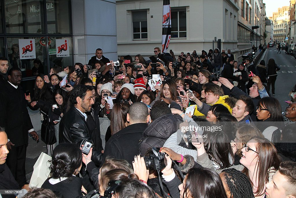 Actress Selena Gomez is surrounded by fans as she signs autographs as she leaves the 'NRJ' radio station on February 18, 2013 in Paris, France.