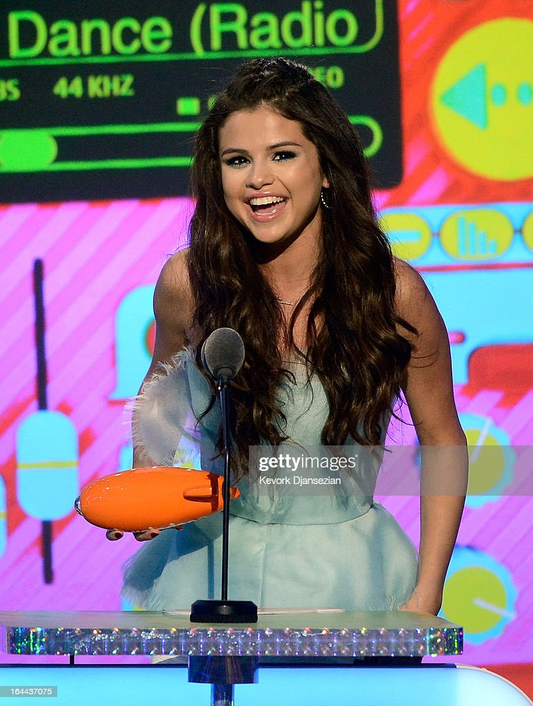 Actress Selena Gomez, winner of Favorite Television Actress for 'Wizards of Waverly Place,' speaks onstage during Nickelodeon's 26th Annual Kids' Choice Awards at USC Galen Center on March 23, 2013 in Los Angeles, California.