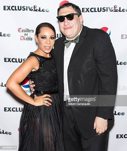 Actress Selenis Leyva and Lee Hernandez attends the New York Launch party for Exclusivlee.com at Stray Kat Gallery on September 18, 2014 in New York...