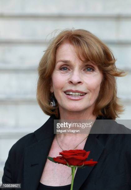 "Actress Senta Berger poses with a rose during the celebration of the 90th jubilee of the ""Jedermann"" play on August 22, 2010 in Salzburg, Austria."