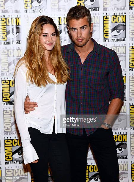 Actress Shailene Woodley and actor Theo James attend the Ender's Game and Divergent press line during ComicCon International 2013 at the Hilton San...