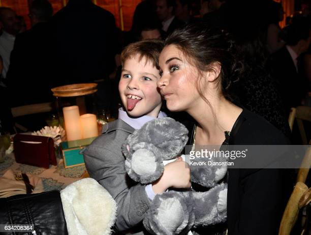 Actress Shailene Woodley makes faces with fellow cast member Ian Armitage during the after party of HBO's 'Big Little Lies' at TCL Chinese Theatre on...