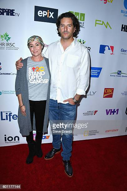 Actress Shannen Doherty and producer Kurt Iswarienko attend Stand Up To Cancer 2016 at Walt Disney Concert Hall on September 9 2016 in Los Angeles...
