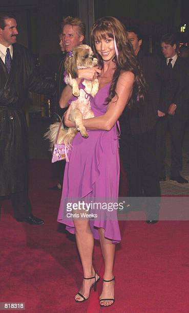 Actress Shannon Elizabeth and her dog Ewok arrive at the premiere of Columbia Pictures'' Tomcats March 28 2001 at the Universal City Walk Cinemas in...