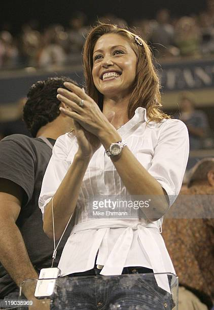 Actress Shannon Elizabeth watches a first round match between Andre Agassi and Andrei Pavel at the 2006 US Open at the USTA National Tennis Center in...