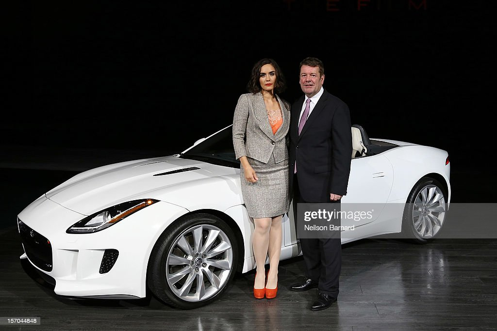 Actress Shannyn Sossamon (L) and Andy Goss, President Jaguar Land Rover North America with the all-new F-TYPE at Jaguar Land Rover's exclusive event, held at Paramount Pictures Studios on November 27, 2012 in Los Angeles, California. Sossamon will be featured in an upcoming film, 'Burning Desire,' to launch the 2014 F