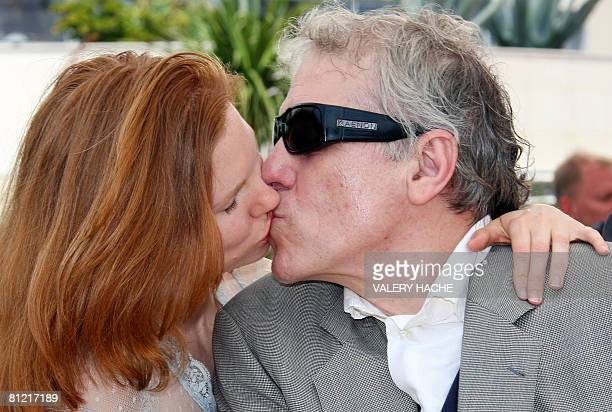US actress Shanyn Leigh kisses US director Abel Ferrara during a photocall for their film 'Chelsea on the rocks' at the 61st Cannes International...