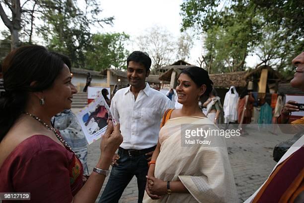 Actress Sharmila Tagore chats with actress Nandita Das with husband Subodh Maskara at the launch of a collection titled Ananta by the SEWA Trade...