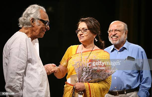 Actress Sharmila Tagore chats with director Mrinal Sen as filmmaker Shyam Benegal looks on at the PSBT Open Frame Festival at the India Habitat...
