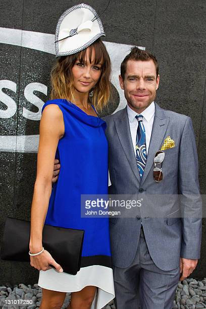 Actress Sharni Vinson and cyclist Cadel Evans pose in The Birdcage on Melbourne Cup Day at Flemington Racecourse on November 1 2011 in Melbourne...
