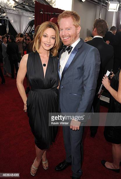 Actress Sharon Lawrence and actor Jesse Tyler Ferguson attend the 20th Annual Screen Actors Guild Awards at The Shrine Auditorium on January 18 2014...