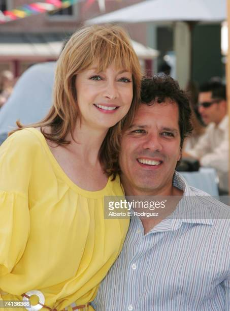 Actress Sharon Lawrence and husband Dr Tom Apostle attend the block party for the 6th Annual Project ALS Benefit on the New York Street set of...