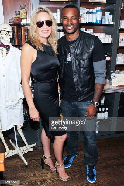 Actress Sharon Stone and actor/model Tyson Beckford pose for a photo at the 3rd Annual Kiehl's Since 1851 LifeRide For amfAR at Kiehl's Since 1851...