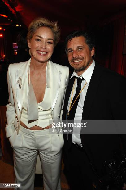 Actress Sharon Stone and celebrity photographer Kevin Mazur attends the 16th Annual Elton John AIDS Foundation Oscar Party sponsored by Ford at the...