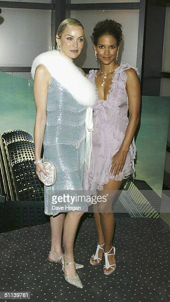 """Actress Sharon Stone and Halle Berry at the European Premiere of """"Catwoman"""" at Vue Leicester Square on August 3, 2004 in London."""