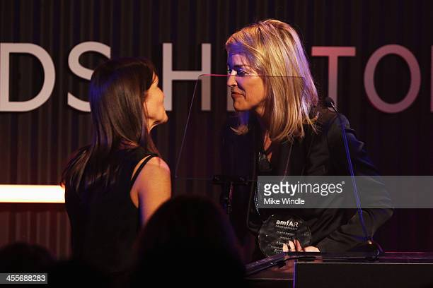 Actress Sharon Stone and honoree Aileen Getty onstage during the 2013 amfAR Inspiration Gala Los Angeles presented by MAC Viva Glam at Milk Studios...