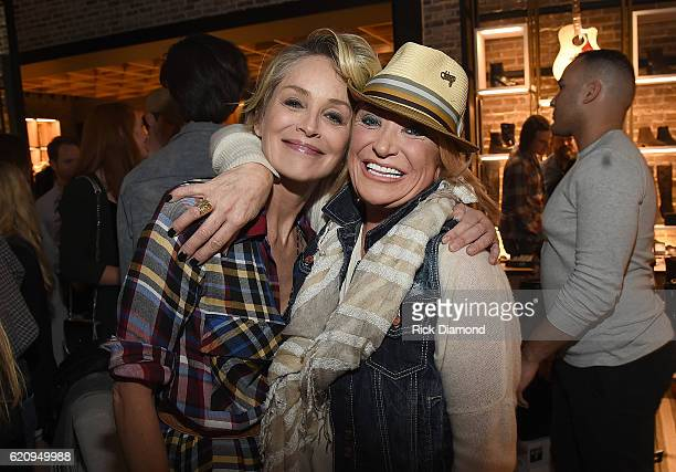 Actress Sharon Stone and musician Tanya Tucker attend the grand opening of FRYE Nashville sponsored by Gibson and Elle Magazine at Frye Boutique on...