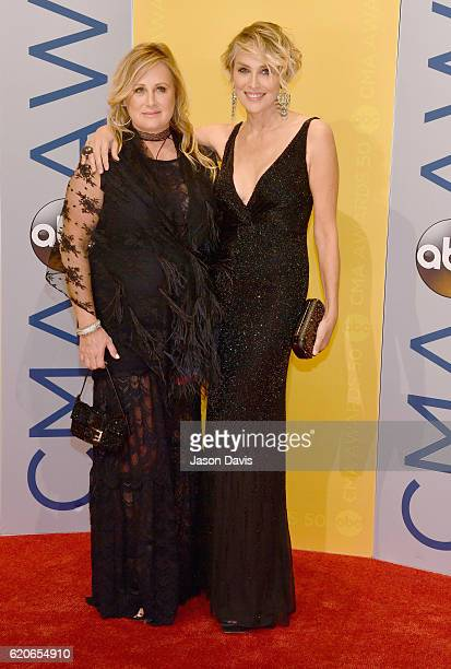 Actress Sharon Stone and sister Kelly Stone attend the 50th annual CMA Awards at the Bridgestone Arena on November 2, 2016 in Nashville, Tennessee.