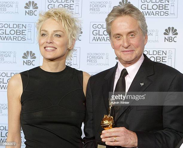 Actress Sharon Stone and Winner of the Cecil B DeMille Award Actor Michael Douglas pose backstage at the 61st Annual Golden Globe Awards at the...