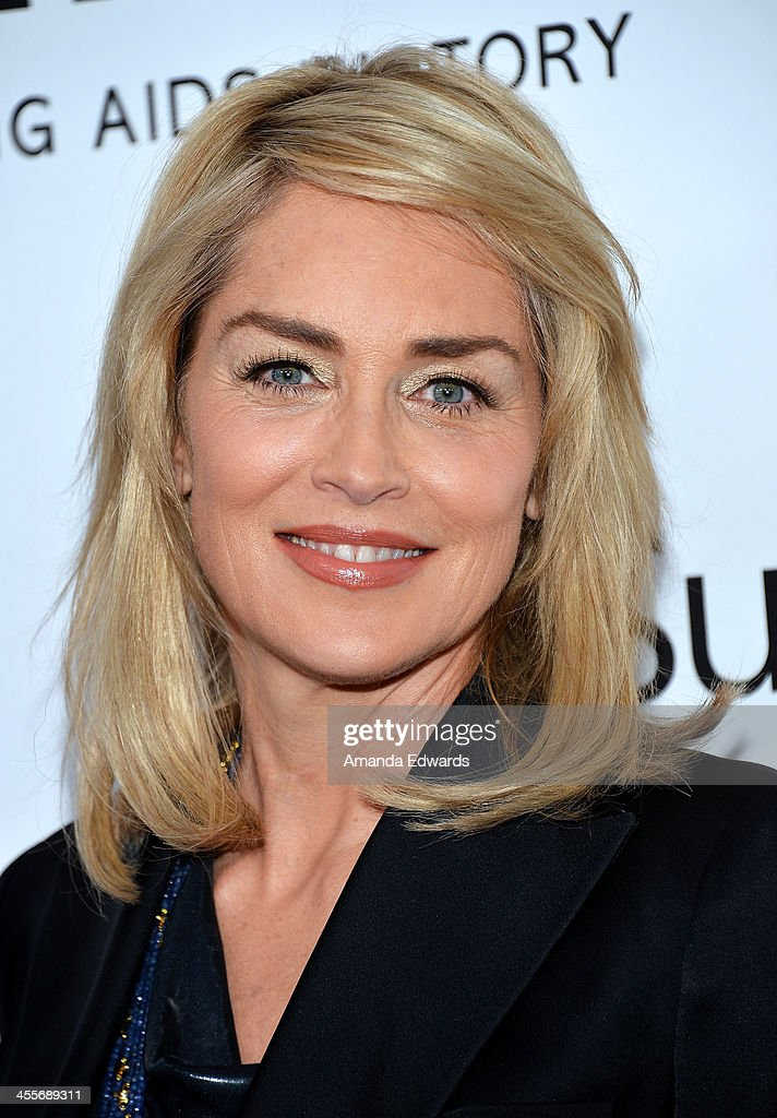 Actress Sharon Stone arrives at amfAR The Foundation for AIDS 4th Annual Inspiration Gala at Milk Studios on December 12, 2013 in Hollywood, California.