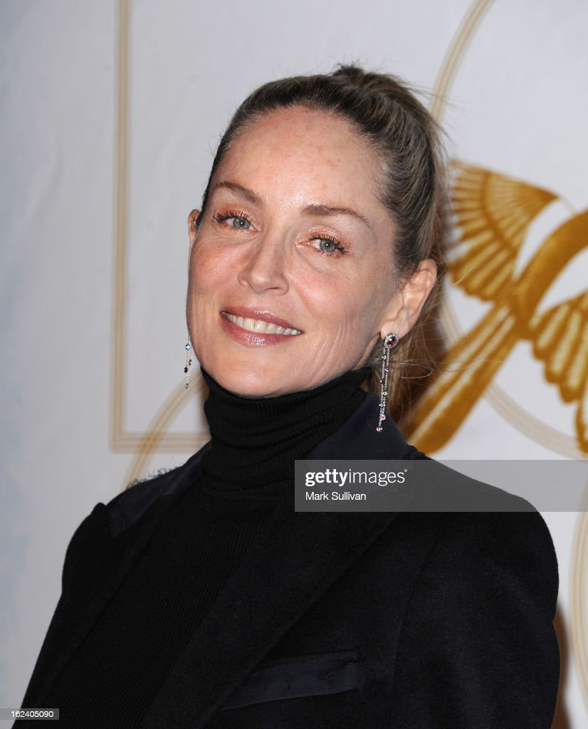 Actress Sharon Stone arrives at the LOVEGOLD cocktail party to celebrate 'How To Survive A Plague' at Chateau Marmont on February 22, 2013 in Los Angeles, California.