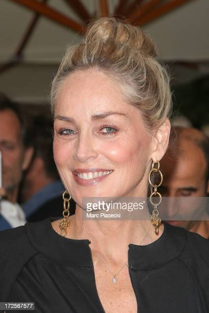 Actress Sharon Stone arrives to attend the 'The Glory of Water' Karl Lagerfeld's exhibition at FENDI store on Avenue Montaigne on July 3 2013 in...