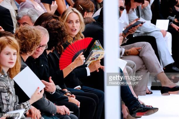 US actress Sharon Stone attends the men's springsummer 2013 fashion collection show of Belgian designer Kris Van Assche for the label Dior on June 30...