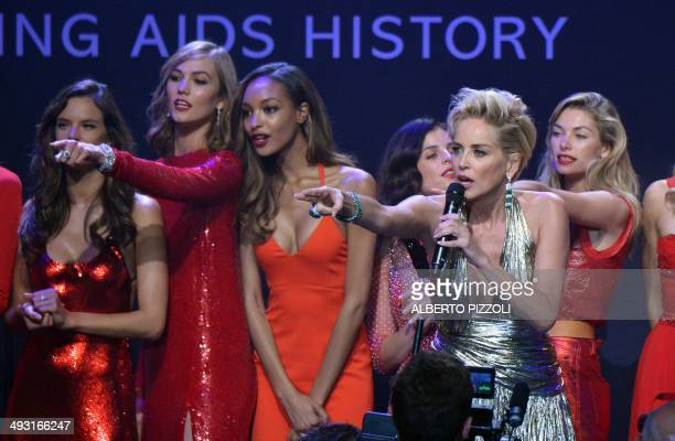 US actress Sharon Stone conduct an auction with Brazilian model Alessandra Ambrosio US model Karlie Kloss British model Jourdan Dunn French art...
