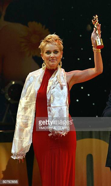 Actress Sharon Stone holds her award for Best Woman Consceness during the 2004 Bollywood Movie Awards at the Trump Taj Mahal 01 May 2004 in Atlantic...