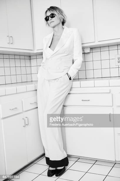 Actress Sharon Stone is photographed for Madame Figaro on January 12 2017 in Los Angeles California Blazer pants sunglasses shoes PUBLISHED IMAGE...