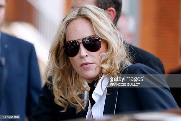 Actress Sharon Stone leaves the men's spring-summer 2013 fashion collection show of Belgian designer Kris Van Assche for the label Dior, on June 30,...