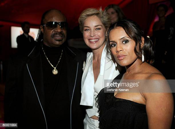 HOLLYWOOD FEBRUARY 24 Actress Sharon Stone musician Stevie Wonder and his wife designer Kai Milla Morris atten the 16th Annual Elton John AIDS...