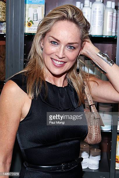 Actress Sharon Stone poses for a photo at the 3rd Annual Kiehl's Since 1851 LifeRide For amfAR at Kiehl's Since 1851 Georgetown on July 20 2012 in...