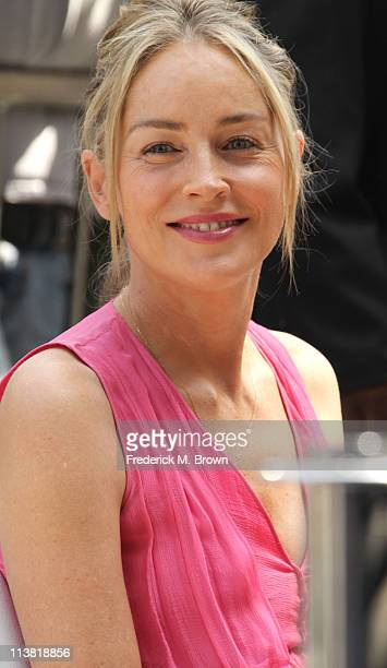 Actress Sharon Stone poses for photographers during the installation ceremony for recording artist Jane Morgan's star on the Hollywood Walk of Fame...