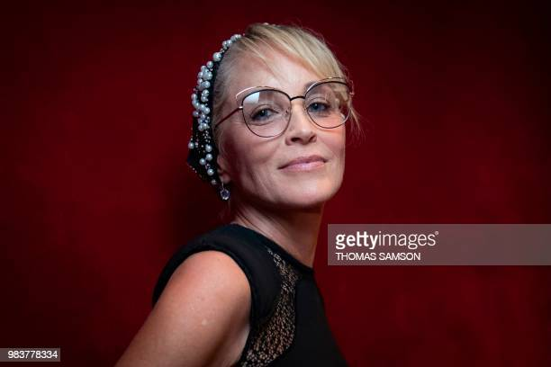 Actress Sharon Stone poses in Paris on June 25 on the final day of the 2018 edition of the Paris Arts and Movie Awards .