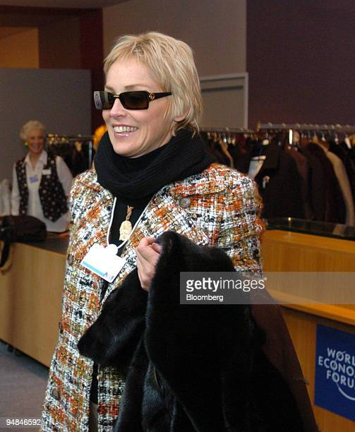 Actress Sharon Stone prepares to go through security at the World Economic Forum in Davos Switzerland on January 26 2005