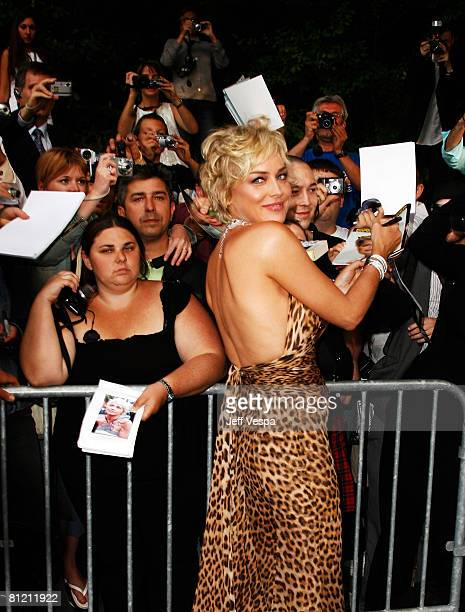 Actress Sharon Stone signs autographs as she arrives at amfAR's Cinema Against AIDS 2008 benefit held at Le Moulin de Mougins during the 61st...