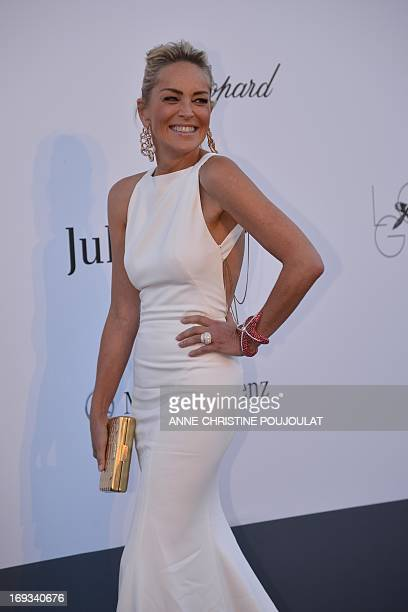 US actress Sharon Stone smiles on May 23 2013 as she arrives for the amfAR's 20th Annual Cinema Against AIDS during the 66th Annual Cannes Film...