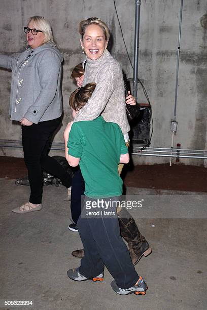 Actress Sharon Stone sons Laird and Quinn Kelly Stone arrive at the Monster Jam at Angel Stadium of Anaheim on January 16 2016 in Anaheim California