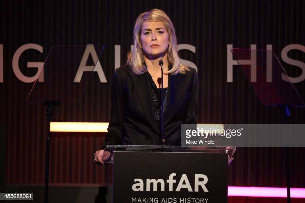 Actress Sharon Stone speaks onstage during the 2013 amfAR Inspiration Gala Los Angeles presented by MAC Viva Glam at Milk Studios on December 12 2013...