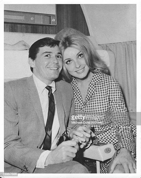 Actress Sharon Tate and hair dresser Jay Sebring pose for a portrait on a plane circa 1966.